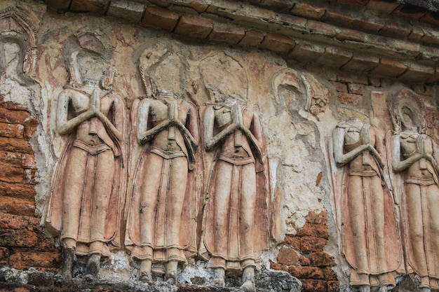 Close-up  ancient buddha is broken in ancient architecture