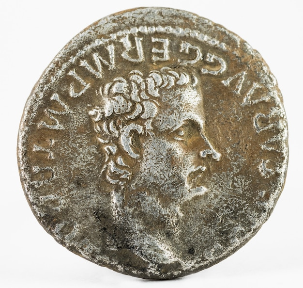 Close up on ancient coin with caligula augustus isolated