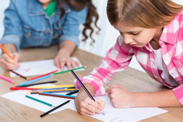 Close-up angle girls coloring