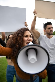 Close up angry people at protest