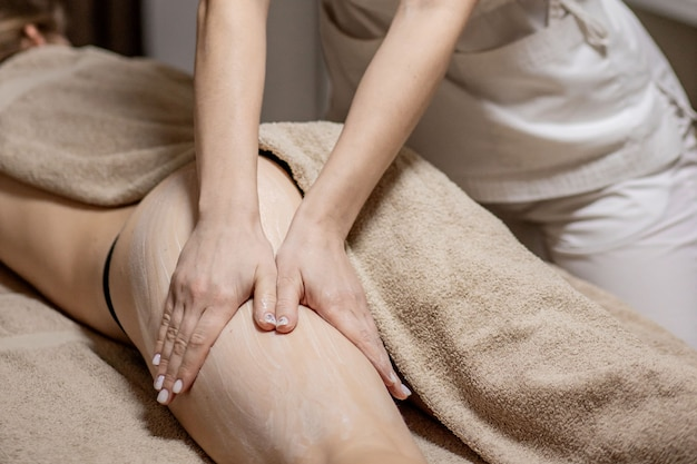 Close up of anti cellulite massage for young woman in wellness center. problems of women body. perfect skin fat burning beauty concept.