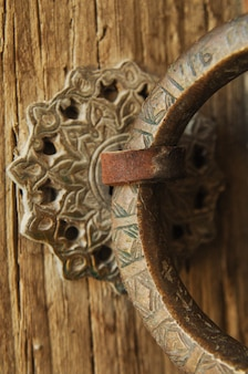 Close-up antique old copper ring with an engraving on the door