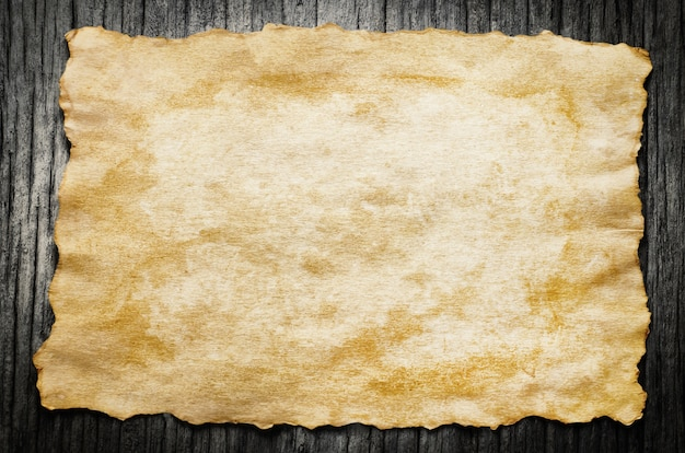 Close up of antique old paper on wooden background