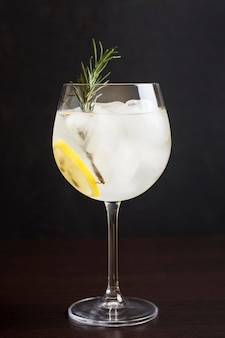 Close-up aromatic cocktail glass with rosemary