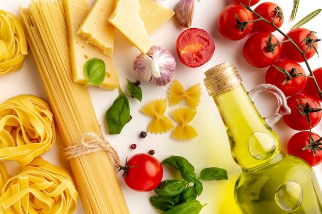 Close up arrangement of uncooked pasta and ingredients