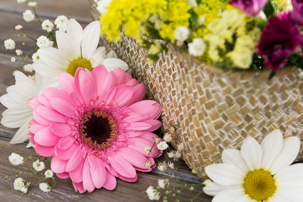 Close-up arrangement with basket of flowers