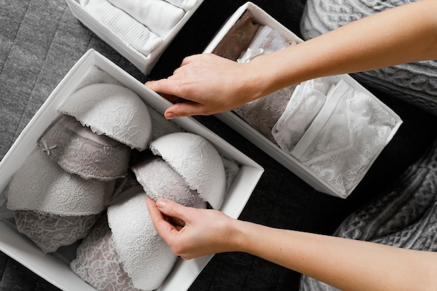 Close up arranging female underwear