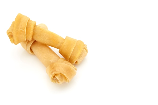 Close up of artificial bone treat for dog and healthy oral hygiene on white background