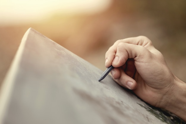 Close-up artist hand with pencil