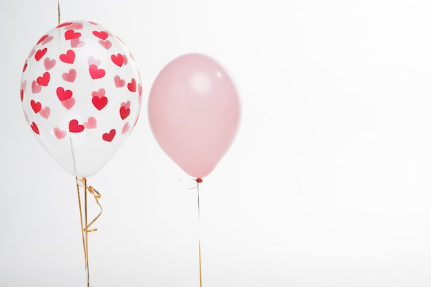 Close-up artistic balloons with heart figures