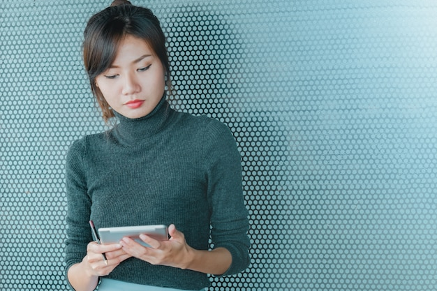 Close up of asian business woman working on tablet