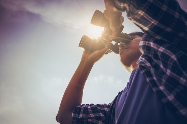 Close-up of asian man hand using binoculars