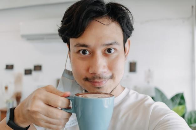 Close up of asian man selfie himself drinks hot coffee