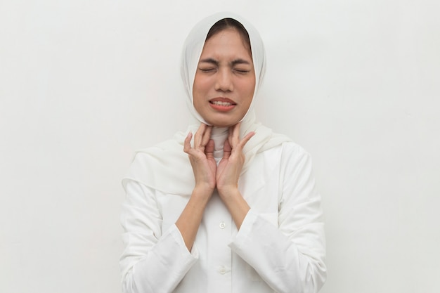 Close up asian muslim woman neck and shoulder pain and injury medical concept