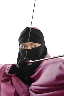 Close up of asian muslim woman ready to shoot an arrow