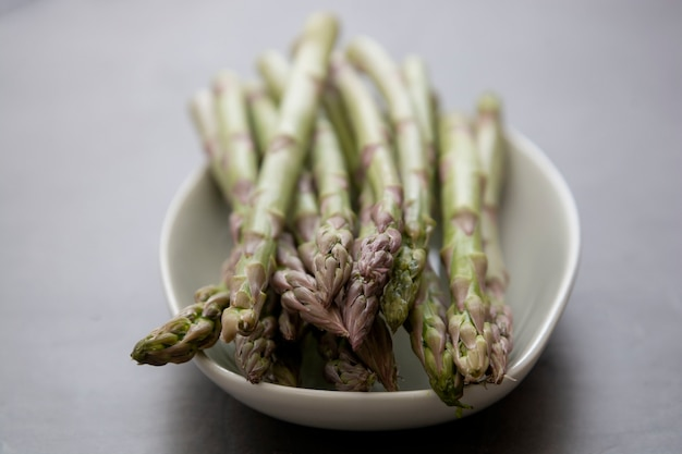 Close up asparagus spears over dark background with copy space. healthy, vegan food concept. clean eating.