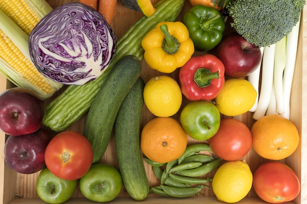 Close up of assorted fruits, vegetables and herb.