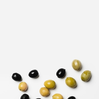 Close-up assortment of fresh olives with copy space