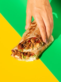 Close-up assortment with burrito and colorful background
