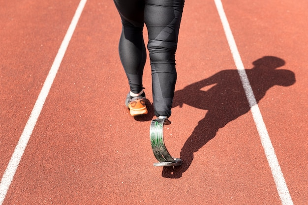 Close up athlete with prosthesis running