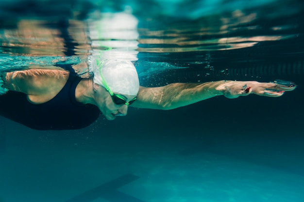 Close up of athletic swimmer swimming
