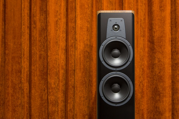 Close up on audio speakers against wall