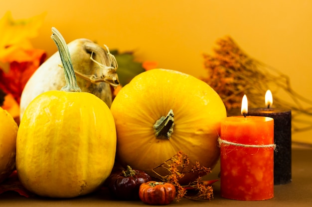 Close-up autumn decorations with candles