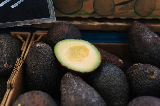 Close-up of avocado in crate