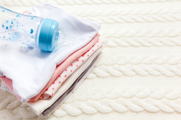 Close up of baby clothes for newborn on table