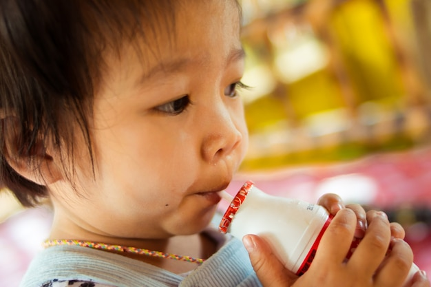 Close up baby drinking pasteurized milk