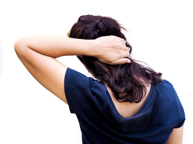 Close-up back of asian women use hands to massage occipital  and neck from acute headaches.