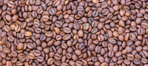 Close up on background of coffee beans texture