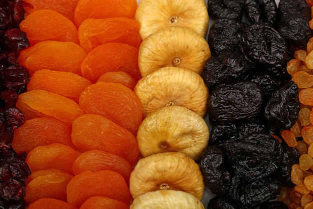 Close up background pattern of assorted sundried fruits, raisins, plums, apricots, figs, high angle view