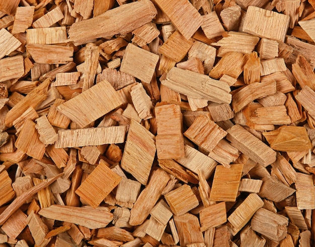 Close up background pattern of hardwood alder chips for food smoking and cooking, elevated top view, directly above