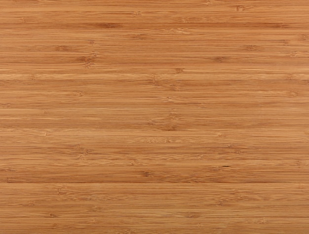 Close up background texture of bamboo wooden cutting board surface