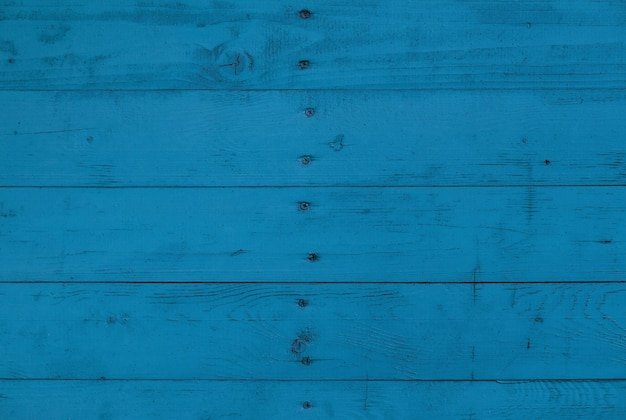 Close up background texture of blue vintage weathered painted wooden planks, rustic style wall panel