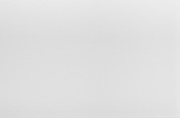 Крупным планом фоновой текстуры пустой белый грубый холст масляной живописи