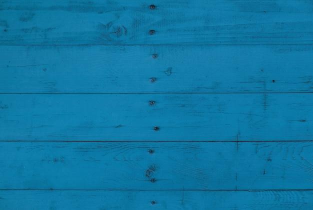 Крупным планом фоновой текстуры синих винтажных выветривания окрашенных деревянных досок, стеновых панелей в деревенском стиле