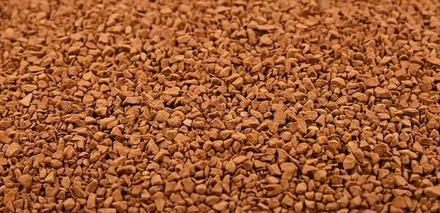 Крупным планом фоновой текстуры сублимированных гранул растворимого кофе