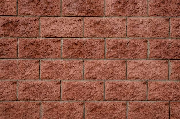 Close up background texture of rectangular red wall bricks