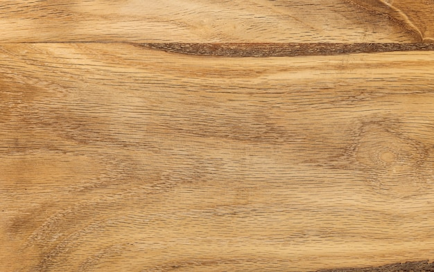 Close up background texture of vintage weathered brown wooden surface with knots and stains
