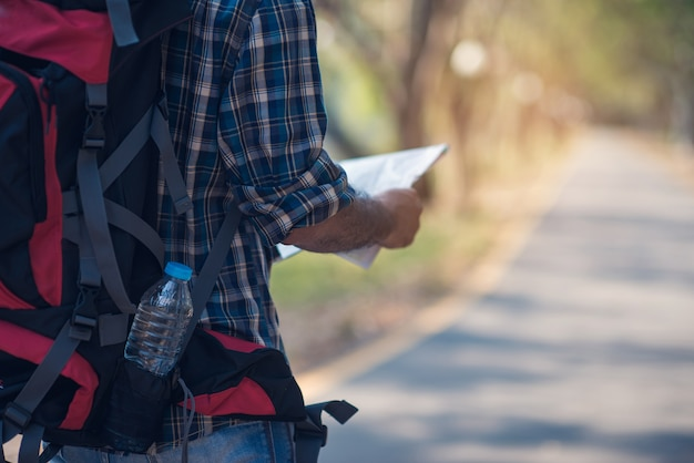 Close up backpacker with holding map