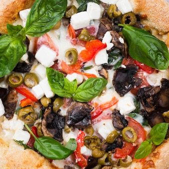 Close-up baked pizza with vegetables