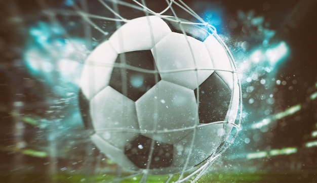 Close-up of a ball entering the net in a football match