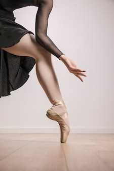 Close up ballerina in pointe shoes
