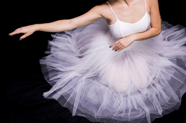 Close up ballerina sitting in dress