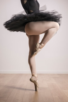 Close up ballerina standing in ballet shoes
