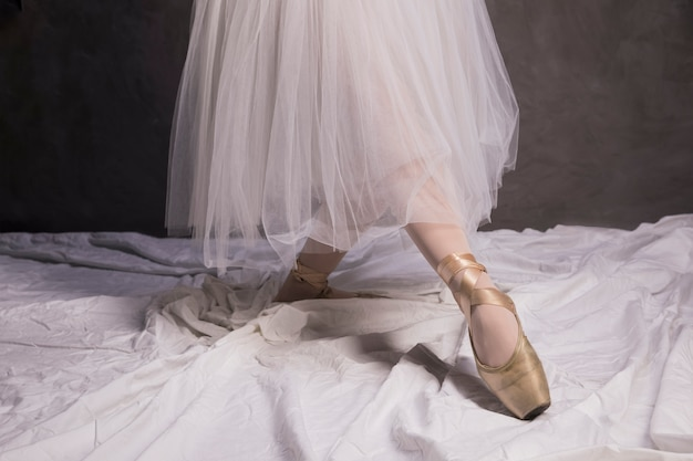 Close up ballet shoes and skirt
