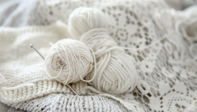 Close-up of balls of yarn for knitting in pastel colors.
