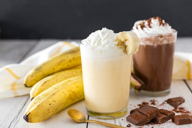Close-up of banana and chocolate milkshakes
